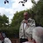 Roger addresses the congregation